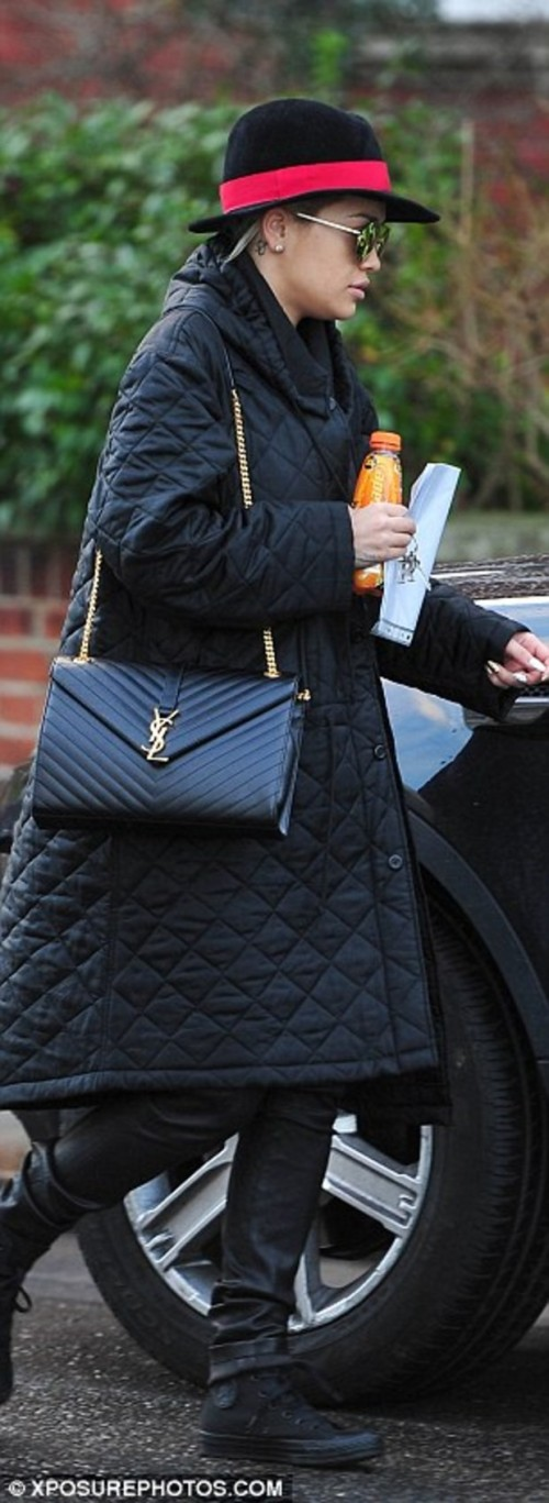 Casual look: Rita Ora covered up in a quilted coat and a chic Gigi Burris fedora as she left her London home on Tuesday afternoon for a business meeting